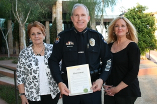 Chief Michael Frazier poses with Rita Coronado, Victim Advocate in the City Prosecutor's Office and Linda Melendez, Victim Advocate in the Surprise Police Department, with the proclamation issued by Mayor Wolcott regarding Sexual Assault Awareness Month.