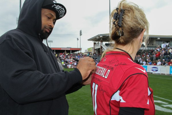Mayor Wolcott getting her jersey signed by Darnell Dockett of the Arizona Cardinals